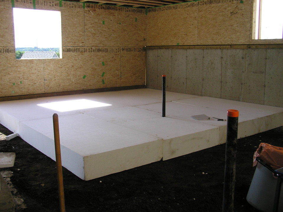 Basement floor slab cottonwood passive house for Slab foundation vs basement